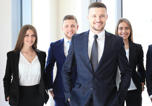 Group of professionals in suit smiling