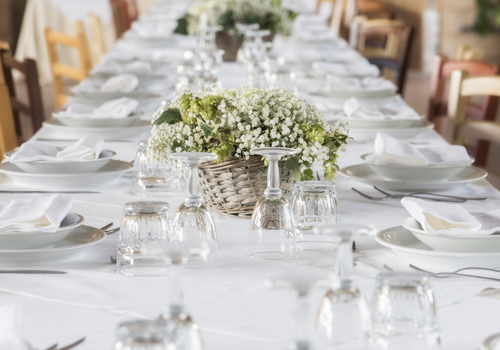 Beautiful table setting with fine linens